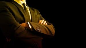 bigstock-Confident-Businessman-Crossing-74775130